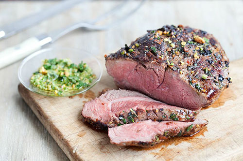 grilled butterflied american lamb leg with mint pistachio pesto